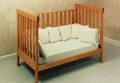 Daybed/toddler conversion kit. Make our crib a co bunk for early days of breast feeding and toddler bed later.