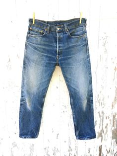 Vintage LEVIS 501xx Denim Jeans 34 Waist Distressed by HuntedFinds