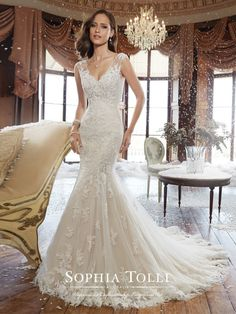Sophia Tolli - Y21507 – Alex - Lace wedding dress with sheer back trimmed with diamante buttons, trumpet gown with V-neckline and hand-beaded cap sleeves, back zipper and chapel length train.Sizes: 0 – 28Colors: Ivory/Black, Café, Ivory, White