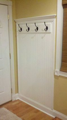 My husbsnd made this Coat rack with prefab MDF wainscotting from Lowes. Love it. #Decorationcoatracks