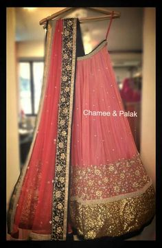 Peach net lehenga by Chamee and Palak