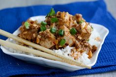 Peanut Butter Mapo Tofu - Mapo tofu is a Szechuan dish usually made with ground pork stir fried with leeks then simmered with tofu in a spicy sauce spiked with Szechuan peppercorns. Adding peanut butter into the mix turns the sauce into a rich, flavorful gravy that's perfect for soaking up with a bowl of white rice.