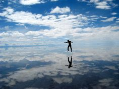 I travel to Bolivia to see the world's largest salt flats—and it's absolutely surreal. This is Salar de Uyuni in Bolivia, the largest salt flats in the world. Imagine an area—even larger than some countries—that. Canal Off, Voyager Loin, Destinations, Beaches In The World, Jolie Photo, Natural Phenomena, South America, Places To See, Adventure Travel