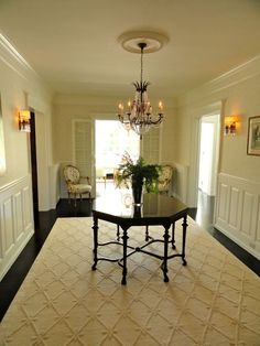 """like the area rug with the dark floors"""