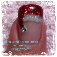 Ho ho ho! Merry Christmas! Father Xmas Hat with diamante gem bauble bell. Red sparkle Ruby ritz, cream puff / studio white with glitter for his fur trim. Finger tip painted as if French manicure then floppy Santa hat makes the best winter nails! All CND Shellac Power Polish over Brisa Lite Gel for strength and protection. Gorgeous festive holidays nail colour. Happy healthy nails  Award winning, freelance nail artist and beautician Sarah Orman @ SO Health and Beauty 07429977674 on…