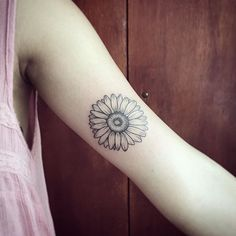 Sunflower or daisy flower tattoo  perfect placement