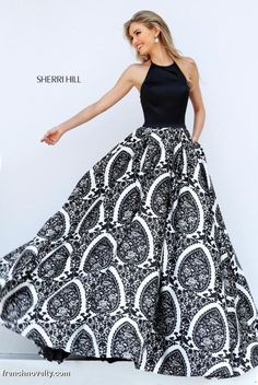 2995e68b9d8 Sherri Hill 50577 is a long printed ball gown with a high halter neckline.  Sherri