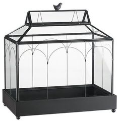 bronze terrarium A classic conservatory look in antiqued bronze iron and copper houses plants behind glass walls with charming wire detail. - Iron and copper wire with antiqued bronze finish - Glass walls - Not watertight - For indoor or sheltered outdoor use