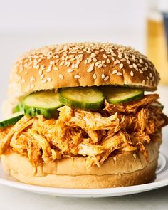 This slow cooker buffalo chicken is the ideal weeknight dinner recipe because it takes less than an hour to make. These sandwiches use rotisserie chicken and a simple buffalo sauce that then gets warmed in the slow cooker. Serve on your favorite bun for a Buffalo Chicken Burgers, Buffalo Chicken Sandwiches, Slow Cooker Recipes, Crockpot Recipes, Cooking Recipes, Crockpot Dishes, Leftover Chicken Recipes, Crock Pot Cooking, Rotisserie Chicken