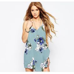 Free People Slate Blue Floral Mini Slip Mini slip features stunning cascading floral detailing. The racer back adds to the feminine appeal. V neckline. String straps , loose fit falls loosely over the body. Free People Dresses Mini