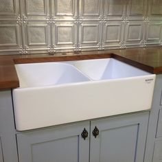 Our showroom solid timber display unit has a pressed metal splashback and a bench top made from recycled brushbox. Contact Heritage for advice on options for your 'real' kitchen.