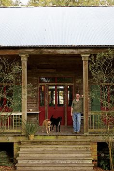 A bayou home - Photo Credit: Brie Williams. Stephen Stirling with his dogs, Billy and Sally.
