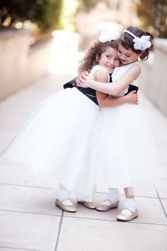Flower girls in white dresses with black sash | photography by http://candicebenjamin.com/