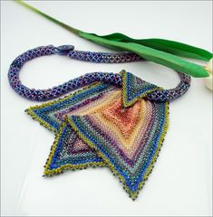 Description  Length: 29 - Bibb pendant = 6 long and wide  Series: Freeform    This was an experiment initially ~ beadweaving is a wonderful way to freeform! I peyote stitched a square and as it got larger and larger, it began to take on a life of its own! I know better than to try