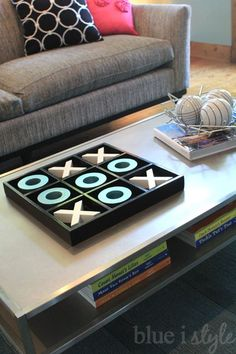 I have two young sons, so my coffee table styling has to be kept to a minimum - but a family favorite is our tic tac toe board. They boys love stacking the lett…