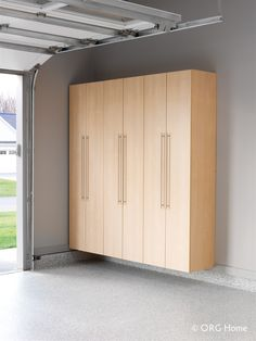 Cabinets By The Garage Doors For Sporting Goods And Rakes And Broom Storage  Innovate Home Org Columbus And Cleveland Ohio