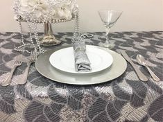 THE RITZ - Shimmering sequins in light and dark silver puts the glitz in The Ritz. Pairs nicely with Granite - Silver napkins. Contact Total Table for sizes and availability.