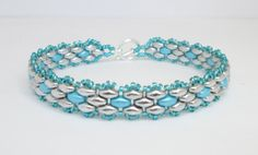 A pretty little super duo bracelet that feels so comfy on the wrist. Made using silver and pastel aqua super duo beads and silver lined turquoise