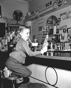In a 1950s Soda Shop. Chocolate sodas at the drugstore soda fountain after a visit to the doctor or dentist. Yum!