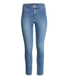 Denim blue. Ankle-length jeans in washed stretch denim with a high waist, mock front pockets, regular back pockets, and skinny legs.