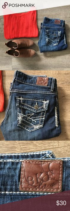 Buckle boot cut jeans BKE stretchy boot cut jeans. On the back right pocket the stitching of the design it's kind of becoming un-stitched but when you wear them you can't notice. Buckle Jeans Boot Cut