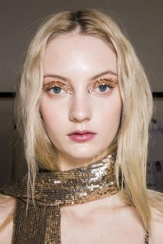 Gold glitter over gold shadow | 50 Statement Eyes For Fall 2015 | StyleCaster