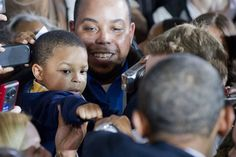 US President Barack Obama gives a young boy a fist bump as he greets guests after speaking about the economy at Shaker Heights High School in Shaker Heights, Ohio, a suburb of Cleveland, on January Barrack Obama, Obama And Biden, Mr President, Barack And Michelle, Young Black, African American History, Photojournalism, Black History, Presidents