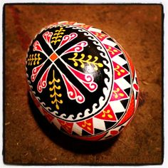 Ukrainian pysanky (Ukrainian Easter egg) from a regular chicken egg.  It is done with a multi-step wax-resist process similar to batik.  To see how they are made, or if you want to create your own, check out my  previous post, How To Make Pysanky         http://dishfunctionaldesigns.blogspot.com/2011/04/how-to-make-pysanky-ukrainian-easter.html