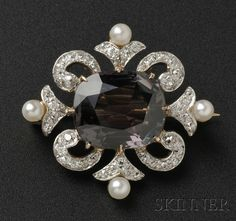Edwardian Alexandrite and Diamond Pendant/Brooch, prong-set with a cushion-cut alexandrite measuring approx. 12.80 x 10.84 x 5.81 mm, weighing 7.27 cts., further set with old mine-cut diamond melee and seed pearls, platinum-topped 14kt gold mount, lg. 1 in.$17,775.00