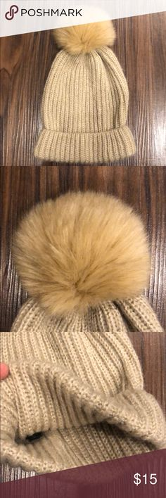 Tan Zara Pom Pom hat Tan winter beanie with matching faux fur Pom Pom. Like new condition only worn a couple of times. Says size Medium but seems like an average OS fit. Zara Accessories Hats