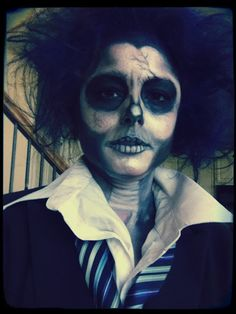 Zombie/skeleton Costume idea.. This was real simple actually -just used eye liner and black & white eye shadow (works best if you wet it upon application). I teased my hair and use bobby pins in back underneath to hold the hair up. I used colored hair spray (got it for $1 from clearance last yr post Halloween sale).