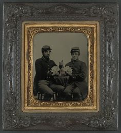 Two unidentified soldiers in Union uniforms drinking whiskey and playing cards. #cw150