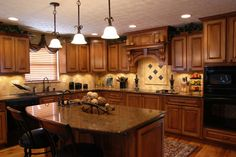 kitchen...granite counters, stained cabinets, dark metals