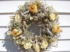 Victorian style dried roses and flowers on a natural WV grapevine wreath in soft colors