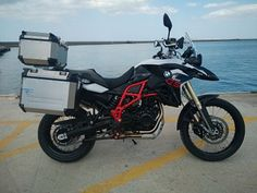 Red and White BMW F800gs with alluminium panniers and full extra, rent a motorbike heraklion airport, motorcycle hire CreteMotorbike rental Crete bike rentals