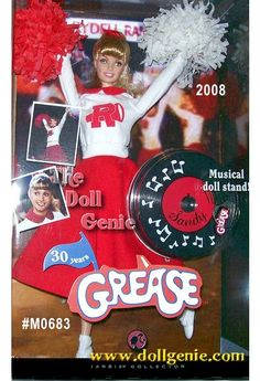 This adorable Sandy Barbie doll wears a reproduction of the cheerleader costume from the pep rally scene where Sandy and Danny are reunited. Can their sweet summer romance still sizzle with the Pink Ladies around - or can a greaser and a cheerleader ever go together at Rydell High?