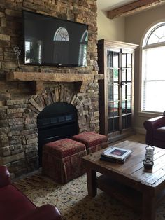 The stone in this great room creates a great place to cozy up in!