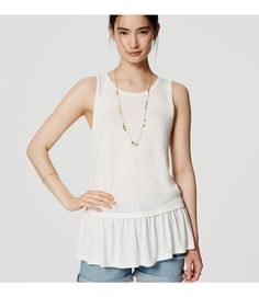 A flowy peplum ups the femme factor of this versatile knit. Round neck. Sleeveless.