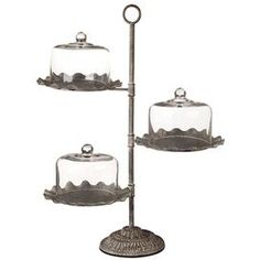 Three-tier fluted metal dessert stand with three glass domes.Product: 3 Tier cake stand    Construction Material: Metal and glass    Features:Movable servers3 TiersGlass domes included    Dimensions: 28 H