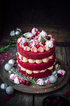 Red Velvet Christmas Cake // Layers of Light Red Velvet Cake, Golden Syrup Buttercream, sweet-tangy, home-made Cranberry Jam with crunchy Meringue and Candied Rosemary leaves