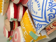 Sample coloured cushions at our 2013 sale Biscuit themed cushions - what's not to love!!