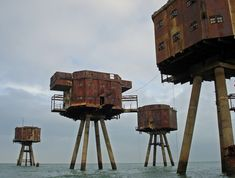 polychroniadis: These rusting sea defences stand nine miles from shore near the entrance to the Thames Estuar (via flickr).