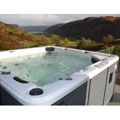 Canadian Spa Company Niagara 60 Jet Acrylic Hot Tub with 60 Jets, Waterfall, Aromatherapy, Pop-Up LED Speakers, and Ozone - The Home Depot Canadian Spa, Tubs For Sale, Pop Up, Jet, Waterfall, Outdoor Decor, Outdoor Ideas, Wa State, Building