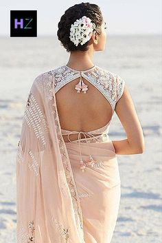 Wearing a saree or lehenga for the ceremony? Complete your chosen look with these simple blouse neck designs for the back, and all eyes will be on you. Saree Jacket Designs, Netted Blouse Designs, Saree Blouse Neck Designs, Choli Designs, Fancy Blouse Designs, Blouse Patterns, Net Saree Blouse, Choli Blouse Design, Saree Dress