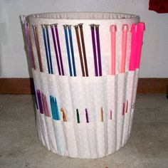 "Blogger, ""I have been having a little trouble keeping track of all my knitting supplies. I needed something to hold all of my supplies and current projects that could easily be tucked away in a closet. I thought that a bucket organizer would be perfect and with knitting needle and crochet hook storage on the outside I could use the inside to hold yarn caddies and works in progress."""