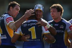 Bowen is congratulated by his Cowboys team-mates - Johnathan Thurston hugs team-mate Matthew Bowen of the Cowboys after he scored a try during the round 25 NRL against the Sharks, September 1, 2013 in Sydney, Australia.