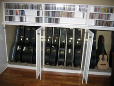 I like that the cases also have somewhere to live, but I like the idea that the guitars don't have to live in their cases. It's more incentive to play if you can open the cupboard and pick it up and play without having to open the case.
