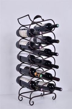 Metal Wine Scroll Stand holds 11 bottles and makes a wonderful display on the table, counter top, or bar. Made of sturdy steel.
