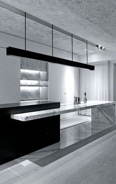 Combine stainless steel island with attached stone table. (YYDG | K-J Residence, 2014)
