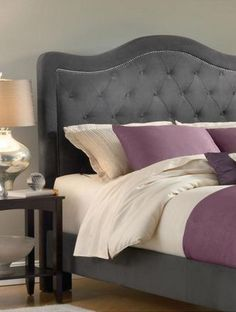 Outfit your bed with the Trieste fabric headboard to accentuate the class and comfort of your bedroom. This upholstered headboard features button and tuck styling and a nail-head trim to add a touch o